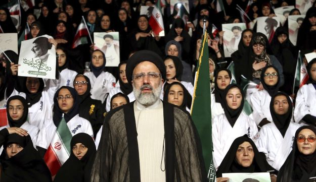 On April 29, 2017, presidential candidate Ebrahim Raisi stands among his supporters, during a campaign rally in Tehran, Iran.