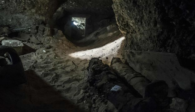 A picture taken on May 13, 2017, shows mummies lying in catacombs following their discovery in the Touna el-Gabal district of the Minya province, in central Egypt.