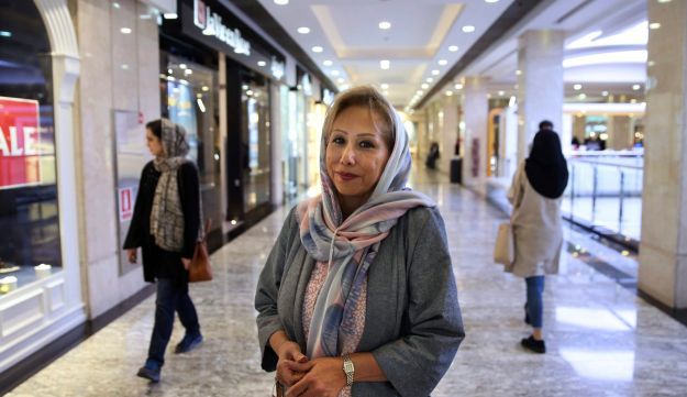 In this Saturday, May 6, 2017 photo, Sholeh Talaeipour, 57, a make-up artist is interviewed by The Associated Press about Iran's presidential election, in the Palladium shopping center, in Tehran.