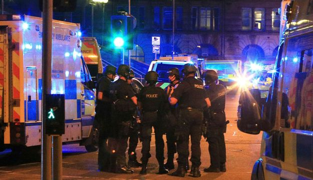 Armed police gather at Manchester Arena after reports of an explosion at the venue during an Ariana Grande gig on May 22, 2017.