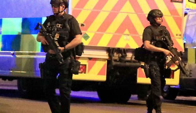 Armed police respond after the explosion at the Manchester Arena, May 22, 2017.