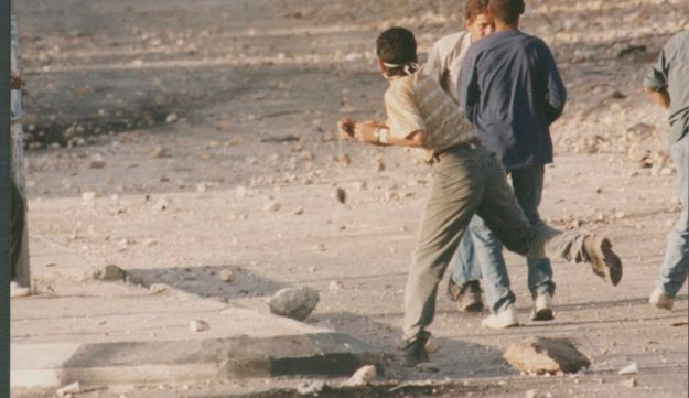 Palestinians throw stones at Israeli soldiers in Bethlehem, West Bank, 1996.