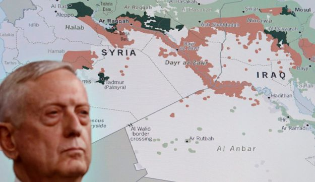 Defense Secretary Jim Mattis stands in front of a map of Syria and Iraq during a news conference at the Pentagon, Friday, May 19, 2017, to give an update on the Islamic State group