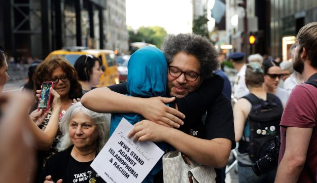 Activist Linda Sarsour (in blue headscarf) hugging a friend at a demonstration and Iftar celebration outside of Trump Tower in New York, June 1, 2017. Earlier Sarsour delivered the keynote speech to CUNY public health students at the Apollo Theater in Harlem.