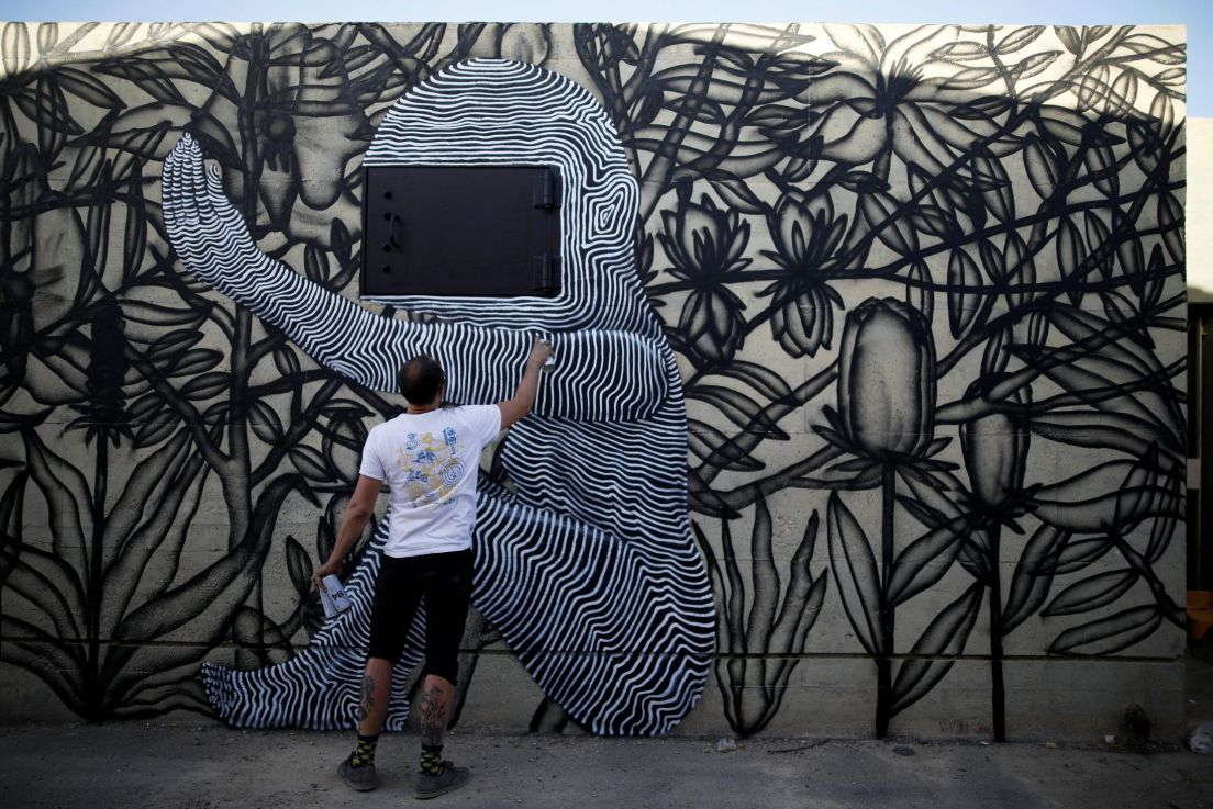 AMIR COHEN REUTERS An Israeli Artist Who Goes By The Name Klone Works On His Wall Painting During POW WOW Israel In Arad June 5 2017