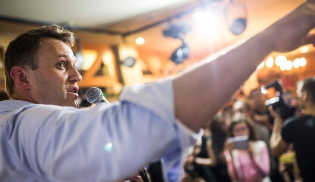 Russian opposition leader Alexei Navalny speaking to people in the city of Perm. In this photo taken on Friday, June 9, 2017, Russian opposition leader Alexei Navalny gestures while speaking to people in the city of Perm, about 1200 kilometers (750 miles) east of Moscow, Russia.