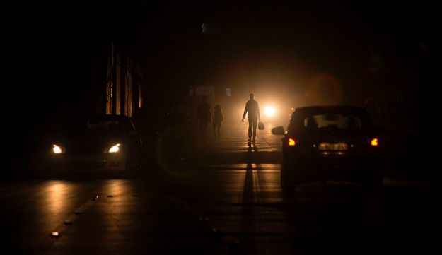 Palestinians walking on a street at the Al-Shati refugee camp in Gaza City during a power outage on June 11, 2017.