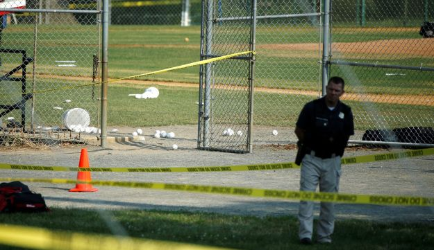 A police officer mans a shooting scene after a gunman opened fire on Republican members of Congress during a baseball practice near Washington in Alexandria, Virginia, June 14, 2017.