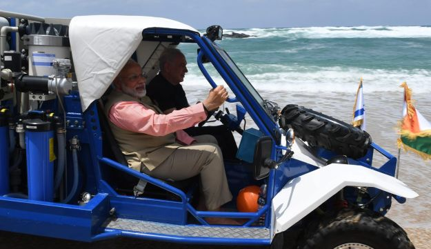 Indian Prime Minister Narendra Modi and Prime Minister Benjamin Netanyahu drive in mobile desalination unit along the shores of the Mediterranean Sea. July 6, 2017.