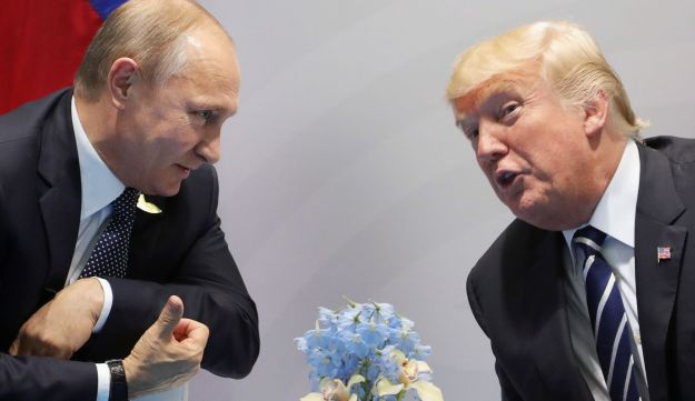 U.S. President Donald Trump (R) and Russia's President Vladimir Putin speaks during their meeting on the sidelines of the G20 Summit in Hamburg, Germany, on July 7, 2017.