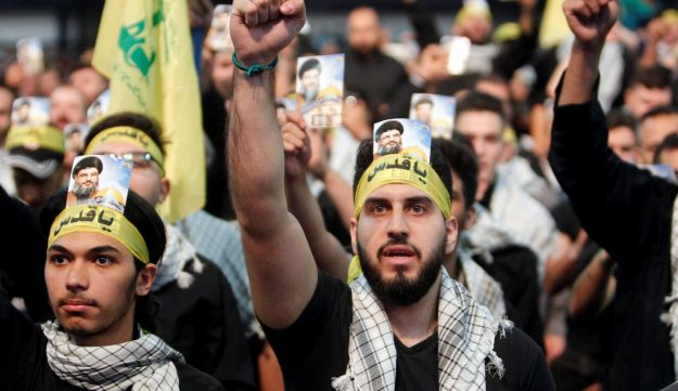 Supporters of Lebanon's Hezbollah leader Hassan Nasrallah chant slogans and gesture during a rally marking Al-Quds day in Beirut's southern suburbs, Lebanon, June 23, 2017.