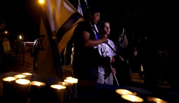 A candlelight vigil in the settlement of Halamish, where a Palestinian stabbed three Israelis to death. July 22, 2017.