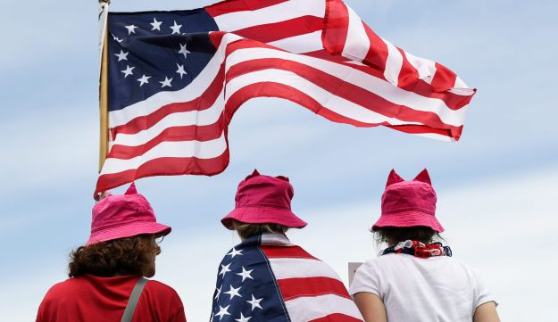 """Demonstrators wear pink 'pussy' hats during the """"March for Truth"""" protest at the Washington Monument. June 3, 2017"""