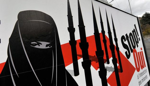 Anti-Muslim campaign posters of the far-right Swiss People's Party:'Stop - Yes to the ban on minarets'. November 23, 2009