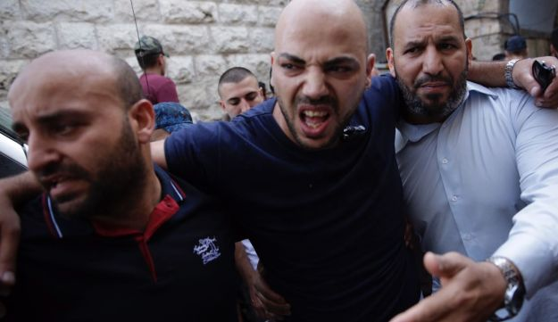 Clashes erupt between worshippers and Israeli forces in Jerusalem's Old City as prayers are held at the Al-Aqsa Mosque compound for the first time in two weeks on July 27, 2017.