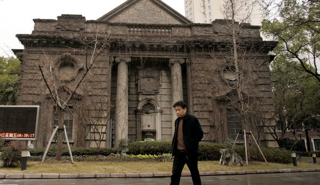 A man walks past the Ohel Rachel Synagogue, which was built in 1920, in Shanghai, China.