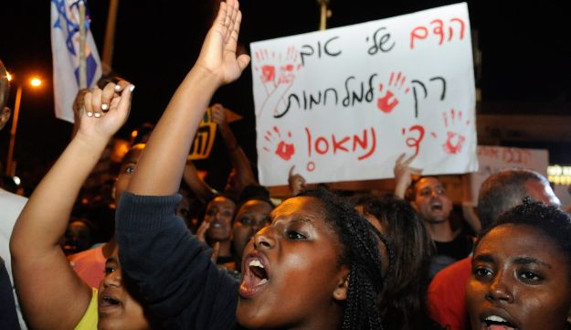 """Ethiopian Israeli's protest against police brutality in Haifa, May 2015. Banner reads """"Our blood is only good for war, I've had enough"""""""