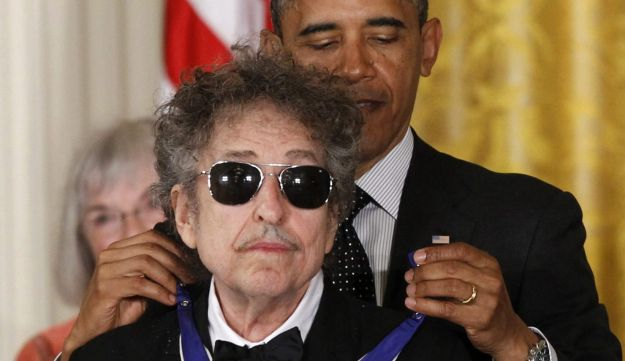 President Barack Obama presents rock legend Bob Dylan with a Medal of Freedom, Tuesday, May 29, 2012