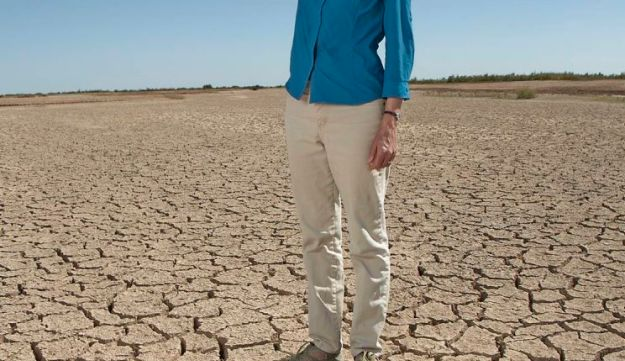 Sandra Postel, director of the Global Water Policy Project, standing on what used to be the bed of the Salton Sea, a tourist spot for weekend sailors that by the way sits smack on the San Andreas Fault. It is now dry.