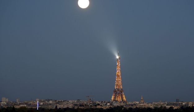 super moon rises in the sky near the Eiffel tower as seen from Suresnes, Western Paris, France, Sept