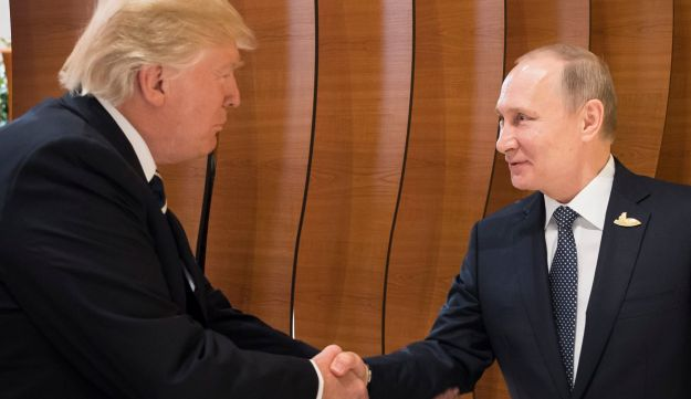 Trump shakes hand with Putin before the first working session of the G-20 summit in Hamburg, Germany, July, 2017.