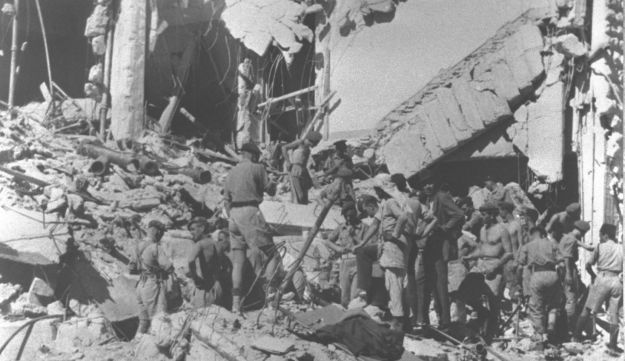 "Rescue workers searching the ruins of the British central government offices in Jerusalem's ""King David"" hotel blown up by ""Etzel"" Jewish underground forces"