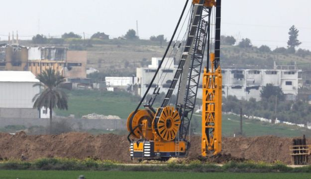 Work on Israel's anti-tunnel barrier on the Gaza border, 2017.