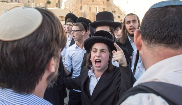 An ultra-Orthodox youth at Jerusalem's Western Wall during a Women of the Wall prayer event.