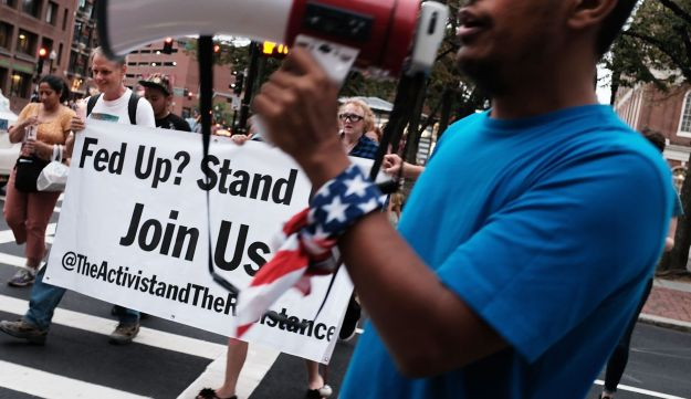 A small group holds a vigil  on August 18, 2017 ahead of controversial rallies in Boston, MA.