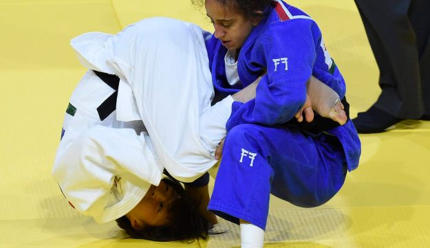 Gili Cohen of Israel and Natsumi Tsunoda of Japan, in white, challenge in the quarterfinal round of the women's 52kg of the Judo World Championships in Papp Laszlo Budapest Sports Arena in Budapest, Hungary, Tuesday, Aug. 29, 2017.