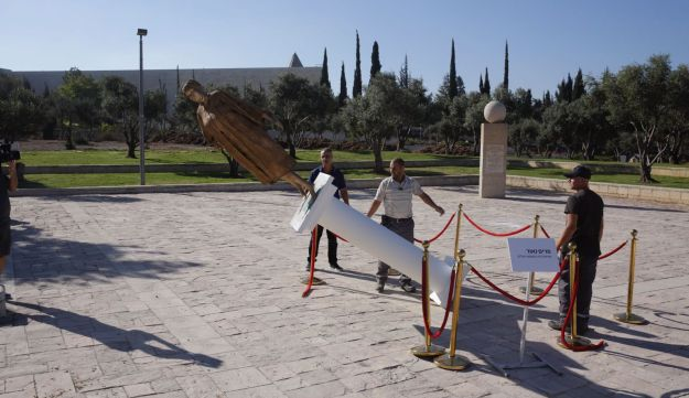 Municipal inspectors remove the statue of Supreme Court President Miriam Naor outside the court in Jerusalem, August 31, 2017.