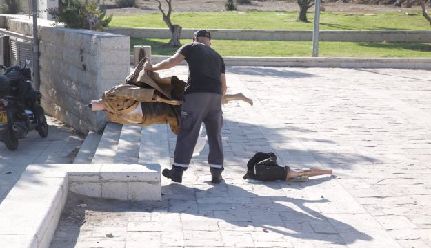 Municipal inspector remove the statue of Supreme Court President Miriam Naor outside the court in Jerusalem, August 31, 2017.