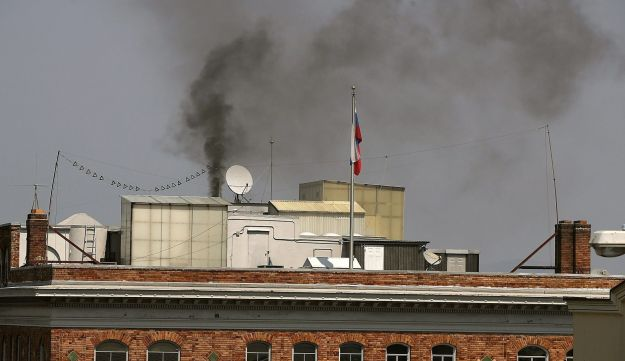 Black smoke billows from a chimney on top of the Russian consulate on September 1, 2017 in San Francisco, California.