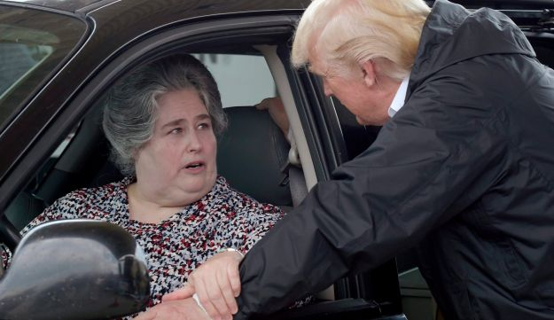 U.S. President Donald Trump talks with a woman after helping to load donated items for people impacted by Hurricane Harvey during a visit to First Church in Pearland, Texas, September 2, 2017.