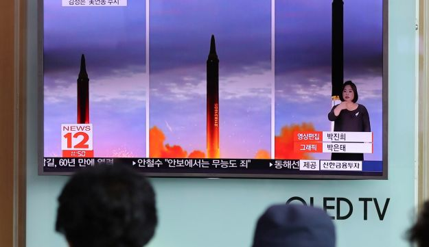 People watch a TV screen showing a local news program reporting about North Korea's missile launch at Seoul Train Station in Seoul, South Korea on Wednesday August 30, 2017.