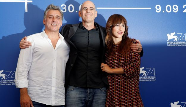 "Director Samuel Maoz poses with actors Lior Ashkenazi and Sara Adler during a photocall for the movie ""Foxtrot"" at the 74th Venice Film Festival in Venice, Italy September 2, 2017."