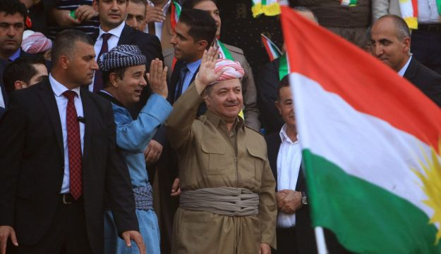 Iraqi Kurdish President Masoud Barzani salutes the crowd while attending a rally to show their support for the upcoming September 25th independence referendum in Duhuk, Iraq September 16, 2017