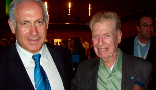 In this May 15, 2008, photo provided by Michael Flint, his father, 101 Squadron veteran Mitchell Flint, right, with Israeli Prime Minister Benjamin Netanyahu, left, attends Israel's 60th Independence anniversary at the Keneseth in Jerusalem. Flint, an American aviator who helped form the Israeli Air Force in 1948 and served in Israel's first fighter squadron has died at age 94. Flint, a former US Navy fighter pilot, died Saturday, Sept. 16, 2017, in Los Angeles of natural causes, said his son, Michael Flint. (Michael Flint/Mitchell Flint Collection via AP)