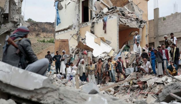 People inspect the rubble of houses destroyed by Saudi-led airstrikes in Sanaa, Yemen, August 25, 2017.