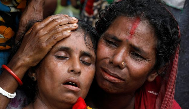 Hindu villagers react as they identify the bodies of their relatives found by government forces, that authorities suspected were killed by insurgents last month, in a mass grave near Maungdaw in the north of Myanmar's Rakhine state, September 27, 2017. REUTERS/Soe Zeya Tun