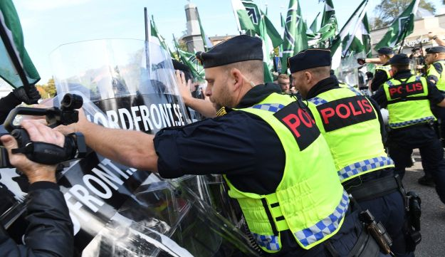 Police officers stop the far-right Nordic Resistance Movement march as it changed the planned route, on September 30, 2017 in Gothenburg, Sweden.