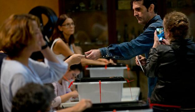 A man votes at the Escola Industrial, a school assigned to be a polling station by the Catalan government, in Barcelona on Sunday October 1, 2017.