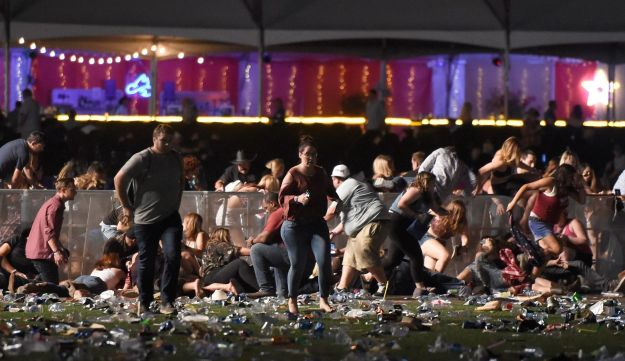 People run from the Route 91 Harvest country music festival after apparent gunfire was heard on October 1, 2017 in Las Vegas, Nevada.