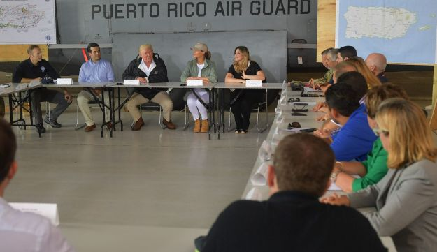 President Donald Trump and First Lady Melania Trump attend a meeting with Governor Ricardo Rossello and other officials in Puerto Rico on October 3, 2017.