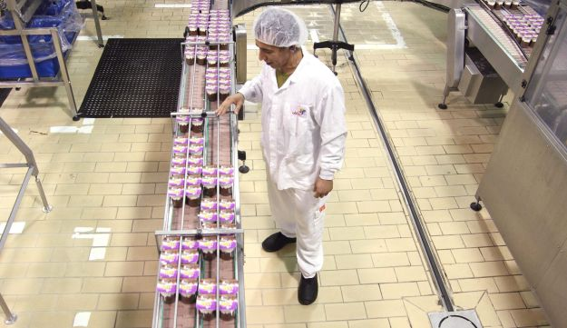 A Strauss Group employee checks products at the food company's manufacturing plant, 2015.