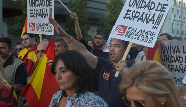 Right wing Falange party supporters attends a rally in Madrid, Spain, Saturday, Oct. 7, 2017