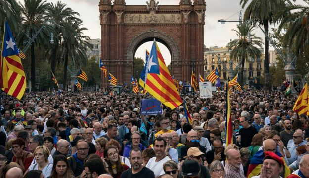 Pro-independence supporters holding Catalan flags take part in rally near the parliament in Barcelona, Spain, October 10, 2017.