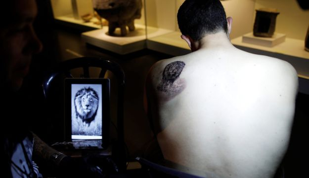 """Ben Baker Morag, who was injured while serving as a soldier in the Israeli army, gets a tattoo done by Swedish artist Niki Norberg as part of the """"Healing Ink """" project."""