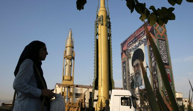 Two types of missiles and a portrait of the Supreme Leader Ayatollah Ali Khamenei are displayed for the 37th anniversary of the 1980s Iran-Iraq war, Tehran, Iran, September 24, 2017.