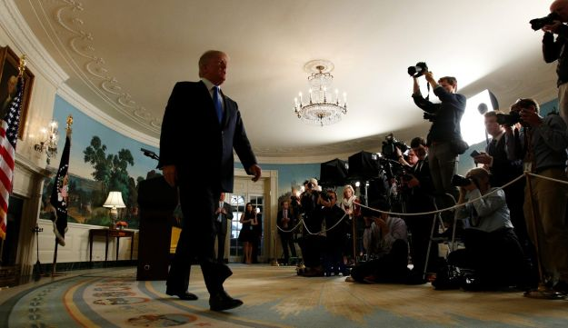U.S. President Donald Trump walks from the Diplomatic Reception Room after speaking about the Iran nuclear deal at the White House in Washington, U.S., October 13, 2017.